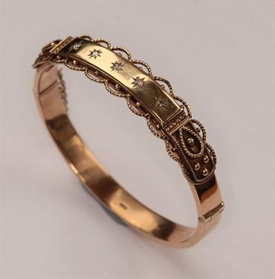 Lot 98 - A 9ct yellow gold diamond set bangle