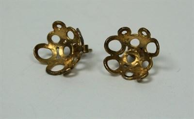 Lot 28 - MIYA HAYES - A pair of yellow metal earrings