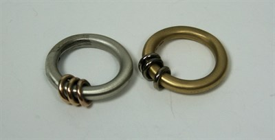 Lot 57 - A pair of 18ct gold rings