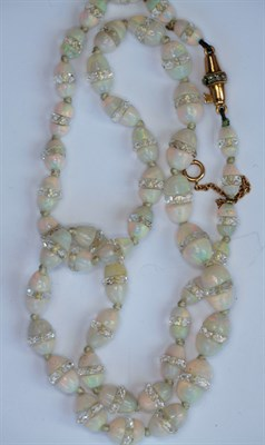 Lot 76 - A Belle Epoque opal and rock crystal bead necklace with diamond set clasp