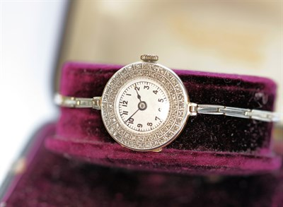 Lot 135 - An early 20th century 18ct gold diamond set cocktail watch