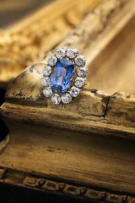 Lot 45 - A large sapphire and diamond set oval cluster ring
