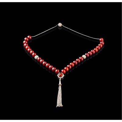 Lot 3 - WHITE METAL AND RED BEADED ROSARY