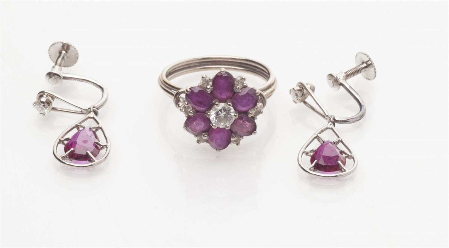 Lot 167-A pair of ruby and diamond earrings and a similar ring