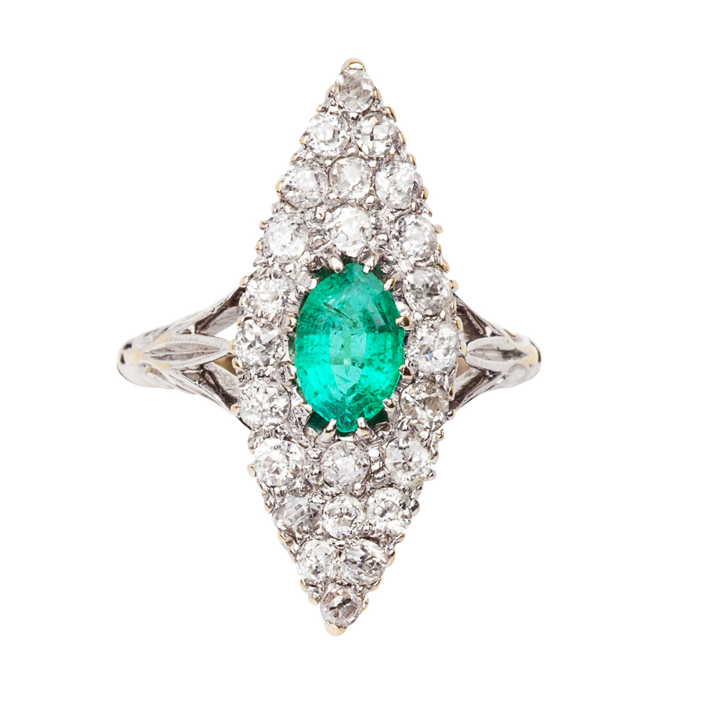 Lot 136-An early 20th century emerald and diamond set cluster ring