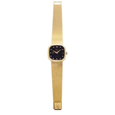 Lot 61-LONGINES - A gentleman's 18ct gold presentation wrist watch