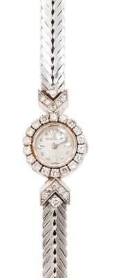 Lot 77-JAEGER LE COULTRE - A diamond set cocktail watch