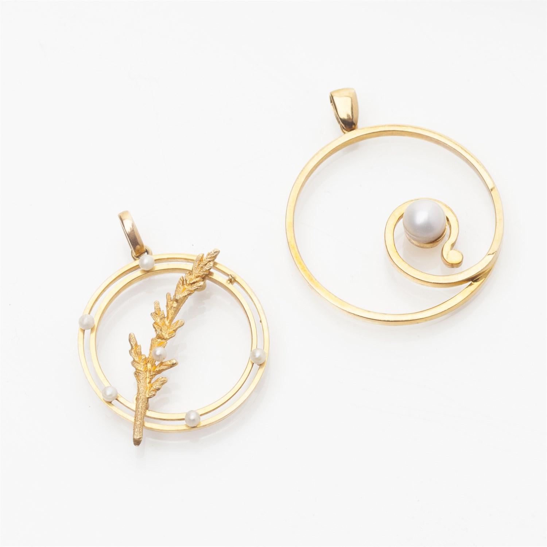 Lot 157-Two pearl set pendants