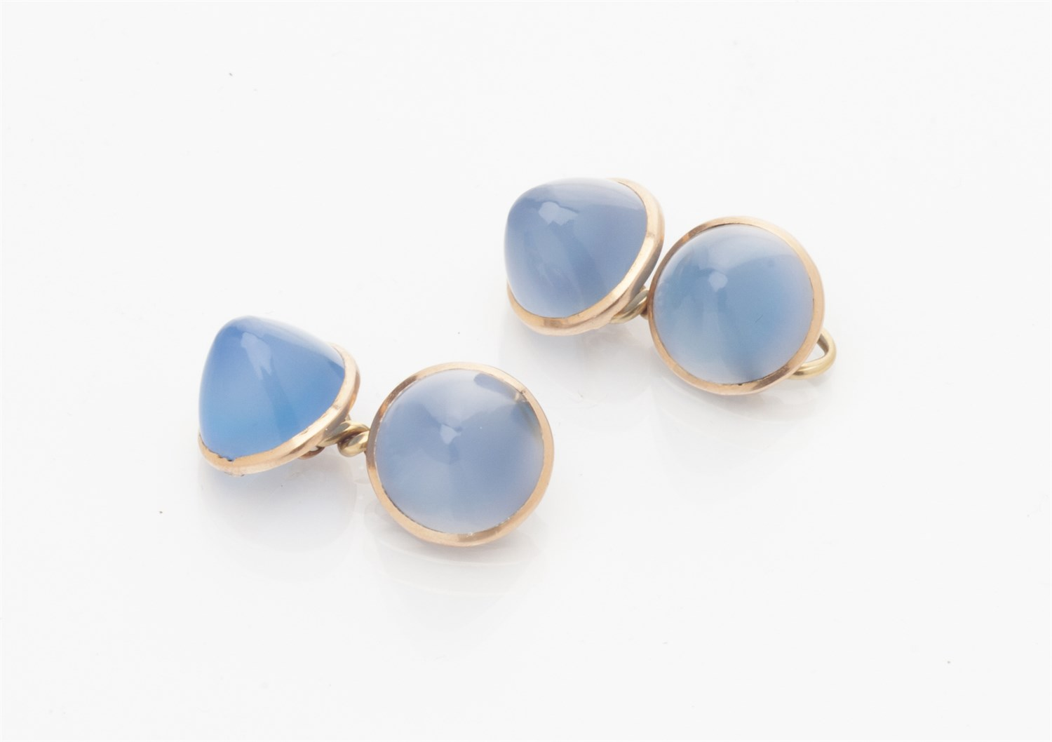 Lot 60-A pair of cabochon chalcedony cufflinks