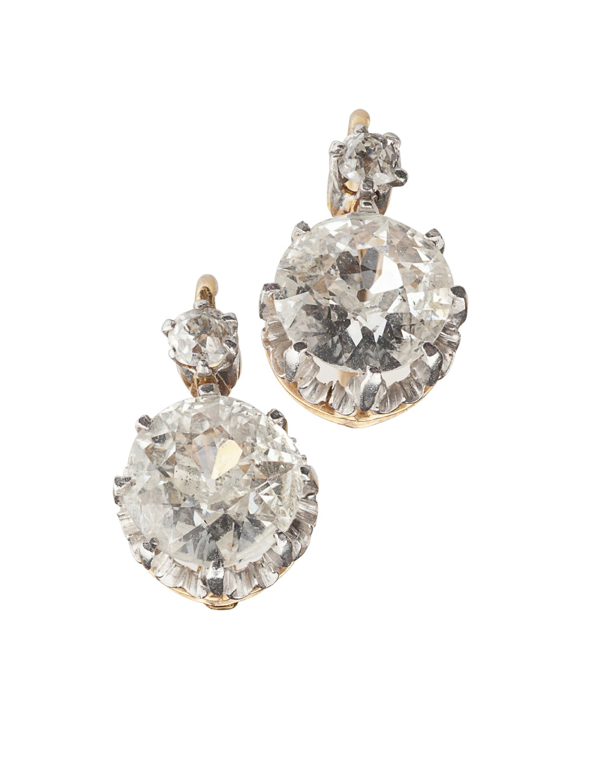 Lot 97-A pair of French gold mounted diamond set pendant earrings