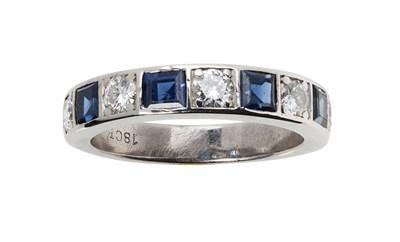 Lot 51 - A sapphire and diamond set half eternity ring