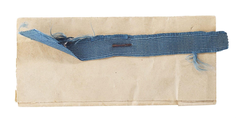 Lot 16-A fragment of blue silk garter