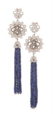 Lot 50 - A pair of sapphire and diamond set pendant earrings