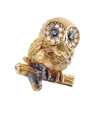 Lot 172 - E WOLFE & CO - An 18ct gold diamond and sapphire set brooch