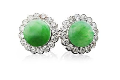 Lot 180 - A pair of jade and diamond set earrings
