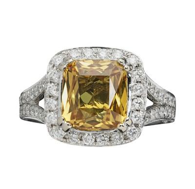 Lot 43 - A yellow sapphire and diamond set ring