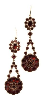 Lot 89 - A pair of garnet set pendant earrings