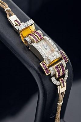 Lot 163 - A 1940s ruby and diamond set lady's wrist watch