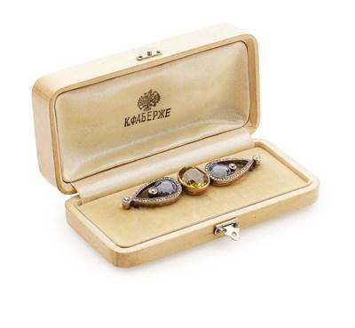 Lot 40 - FABERGÉ - A diamond and sapphire set brooch