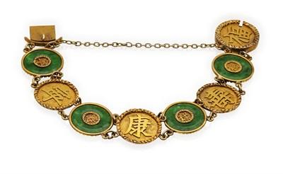 Lot 79 - A jade and gold bracelet