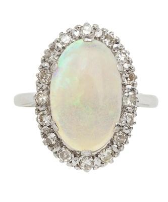 Lot 136 - An opal and diamond set ring