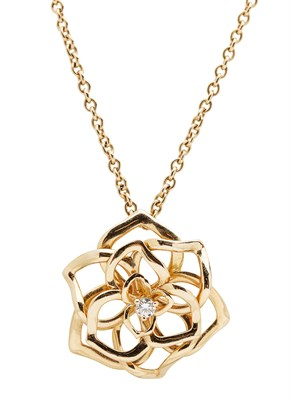 Lot 1 - PIAGET - A rose gold pendant and chain