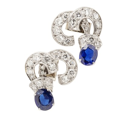Lot 46 - A pair of diamond and sapphire set earrings