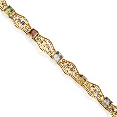 Lot 80 - CARLO GIULIANO - A multi gem set, gold and enamelled bracelet