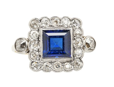 Lot 48 - A sapphire and diamond set cluster ring