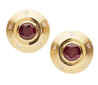 Lot 140 - A pair of garnet and diamond set earrings