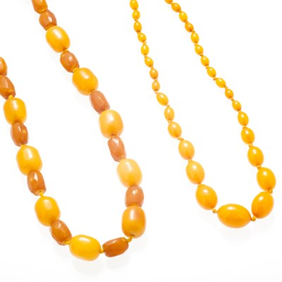 Lot 151 - Two yellow beaded necklaces