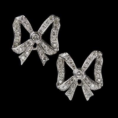 Lot 82 - A pair of diamond set earrings