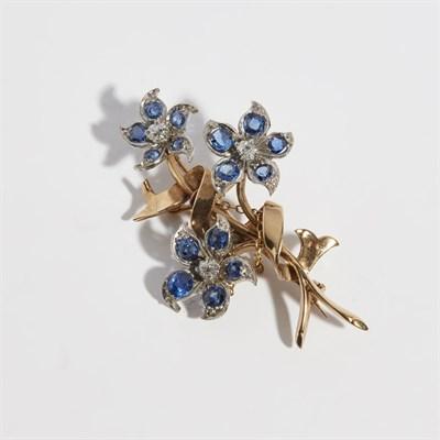 Lot 48 - A sapphire and diamond set floral spray brooch