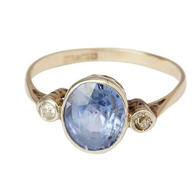 Lot 50 - A sapphire and diamond set three stone ring