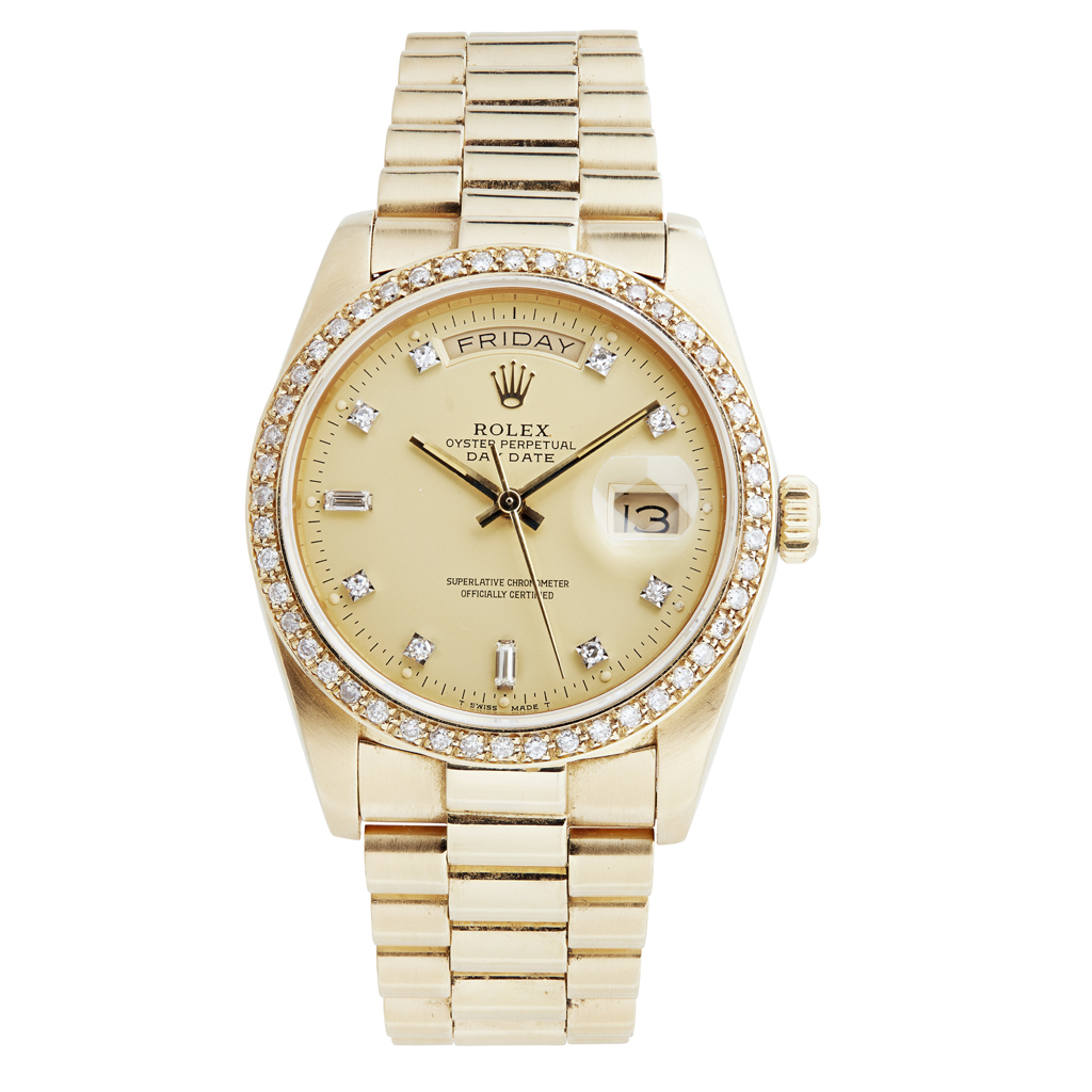 243 - An 18ct gold and diamond set gentleman's wrist watch, Rolex