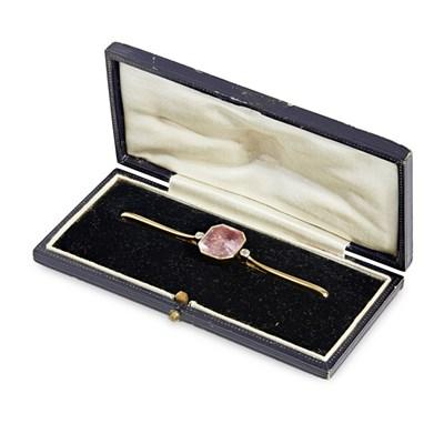 Lot 123 - A pink tourmaline and diamond set brooch