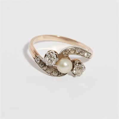Lot 159 - A pearl and diamond set crossover ring