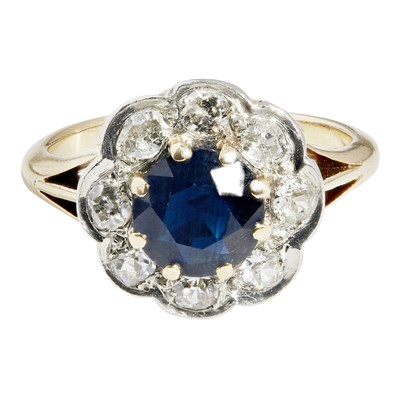 Lot 65 - A sapphire and diamond set cluster ring