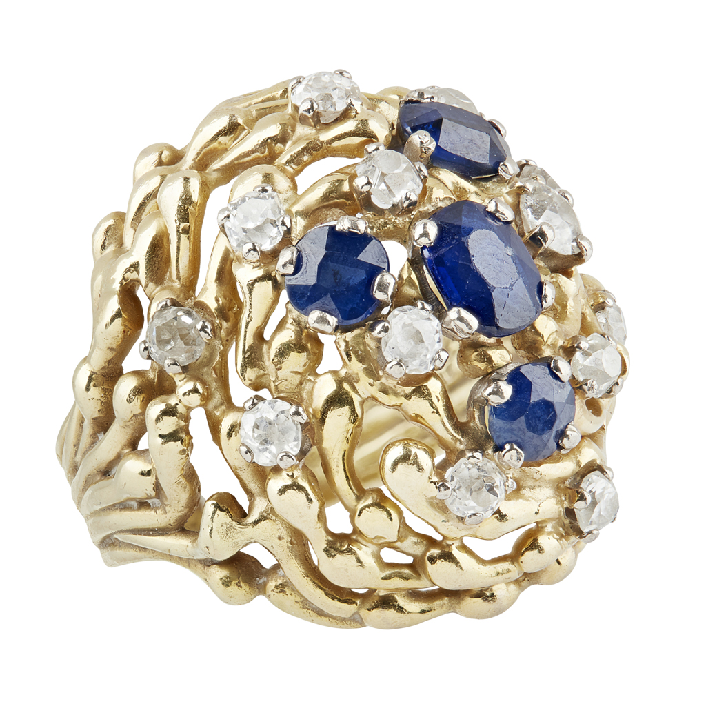 77 - A 1970s 18ct gold sapphire and diamond set ring, John Donald