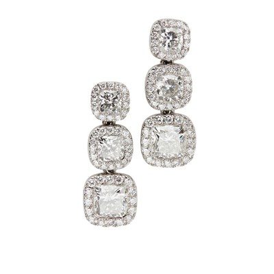 Lot 45 - A pair of 18ct white gold and diamond set pendant earrings, De Beers