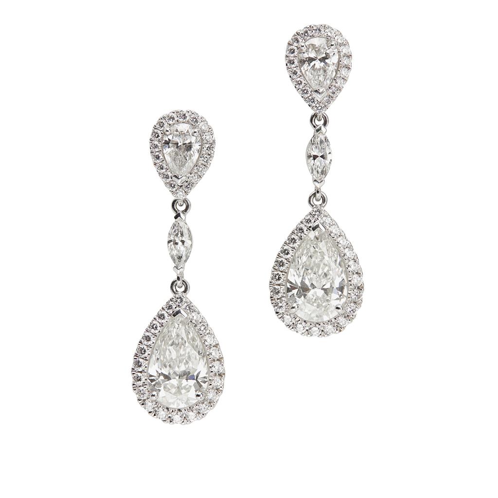 Lot 42 - A pair of platinum and diamond set pendant earrings, De Beers