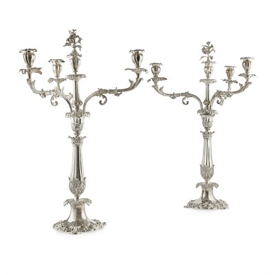 Lot 495 - A pair of  William IV four light table candelabra