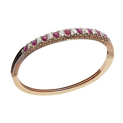 Lot 29 - A ruby and diamond set hinged bangle