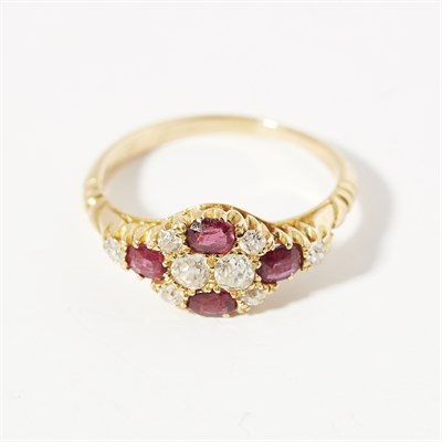Lot 39 - A ruby and diamond set cluster ring
