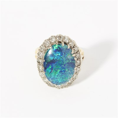 Lot 137 - A black opal triplet and diamond set cluster ring