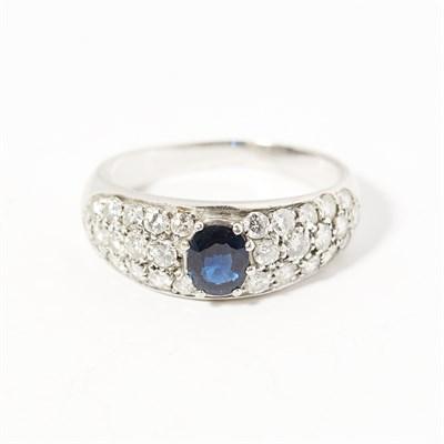 Lot 54 - A sapphire and diamond set ring