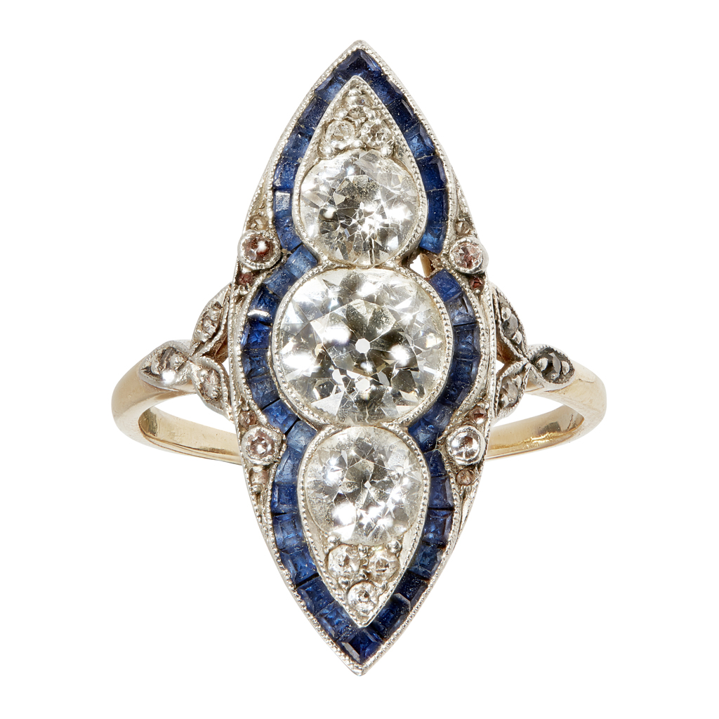 Lot 23-An early 20th century diamond and sapphire set cluster ring