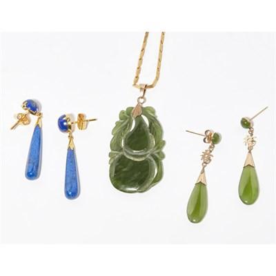 Lot 149 - A carved jade set pendant