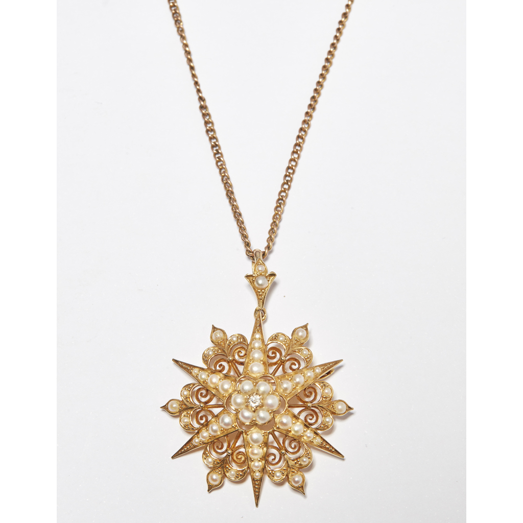Lot 14-A late Victorian seed pearl and diamond set pendant
