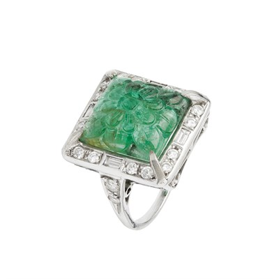 Lot 12 - A carved emerald and diamond cluster ring